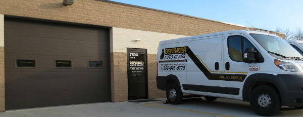 mentor auto glass repair center with van in front of building