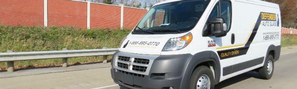 complete side view of white Defender repair van