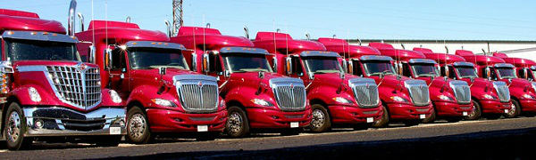 bright red semi trucks with chrome grills
