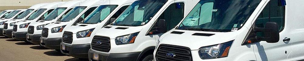 Closer shot of vans parked in lot